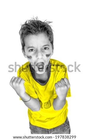 one brazilian soccer football fan kig screaming goal in black and white with yellow shirt. Studio, isolated on white background