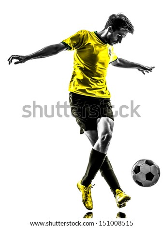 one brazilian soccer football player young man dribbling in silhouette - stock photo