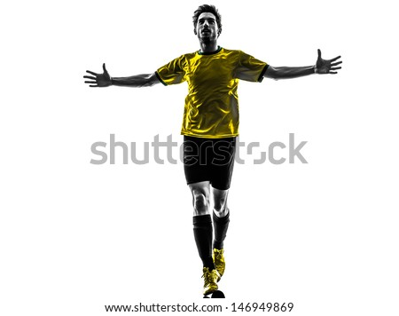 one brazilian soccer football player young man happiness joy  in silhouette studio  on white background - stock photo