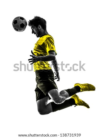 one brazilian soccer football player young man heading in silhouette studio isolated on white background - stock photo