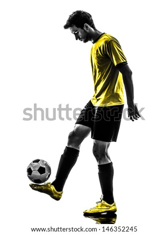 one brazilian soccer football player young man juggling in silhouette studio  on white background - stock photo