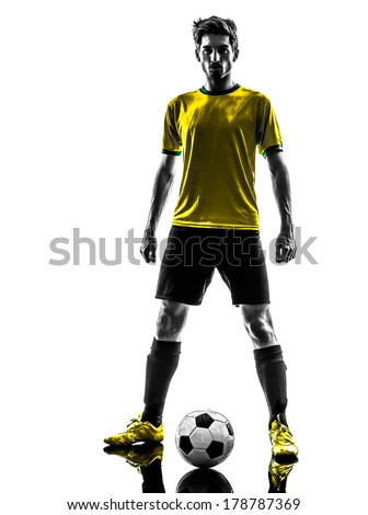 one brazilian soccer football player young man standing defiance in silhouette studio on white background - stock photo