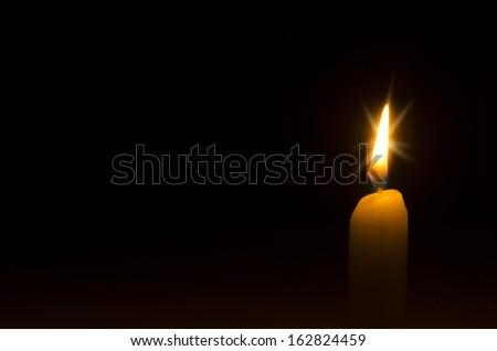 One bright burning candle - stock photo