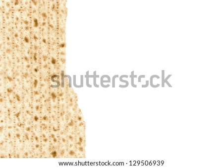 One broken matzo piece for the Passover seder afikoman. Half of a cracked matzo positioned to the left of the photo. Horizontal view with lots of room for text. Isolated on a white background. - stock photo