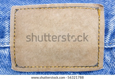 One  brown label on blue jeans - stock photo