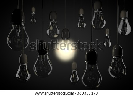 One bulb lighting up room with hanging light bulbs on wires - stock photo