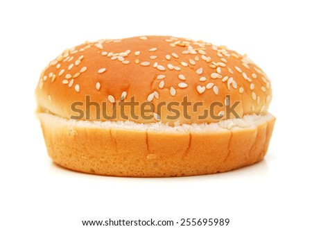 One bun with sesame seeds on a white background  - stock photo