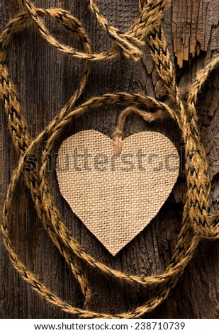 One burlap hear with coarse twine set of rustic wood - stock photo