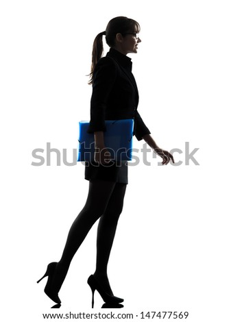 one business business woman holding folders files walking silhouette  silhouette studio isolated on white background - stock photo