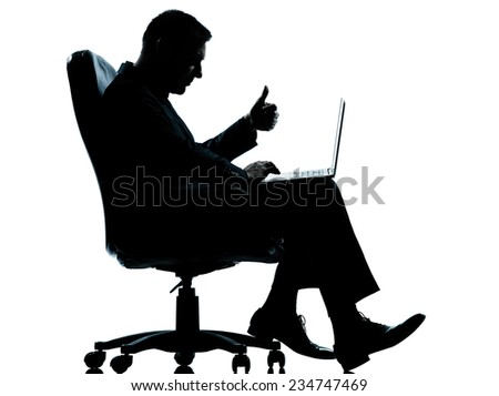 one  business man computer computing thumb up sitting in armchair silhouette Full length in studio isolated on white background - stock photo