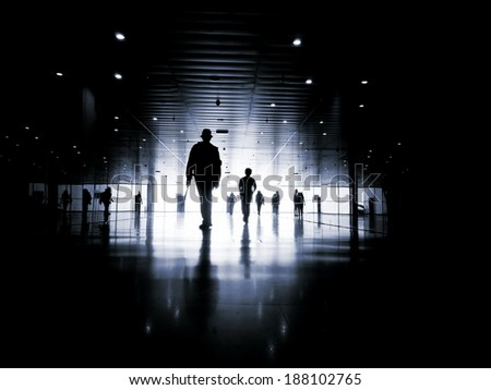 one business people walking down the street talking. Silhouettes. - stock photo