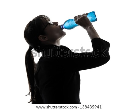 one business woman drinking water energy   silhouette studio isolated on white background