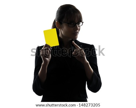 one business woman showing yellow card  silhouette studio isolated on white background - stock photo