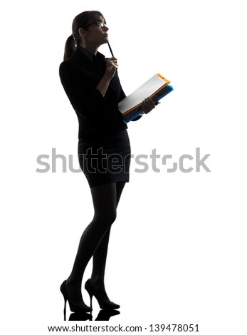one business woman th k g hold g folders files  silhouette studio isolated on white background - stock photo
