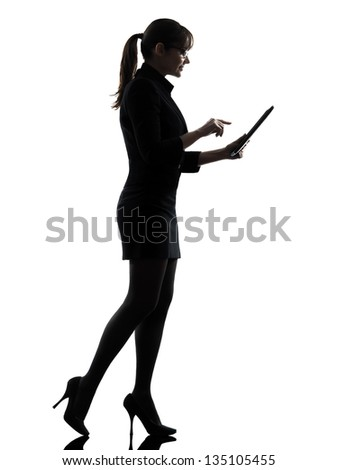 one business woman walking computer computing typing digital tablet  silhouette studio isolated on white background