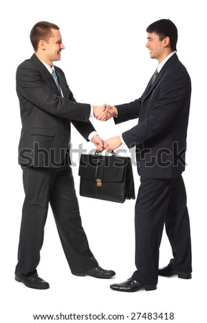 One businessman gives another briefcase full body