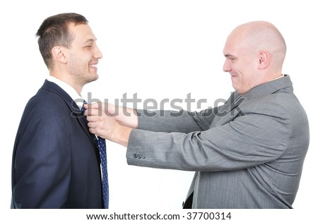 One businessman teaching another one how to tie his tie
