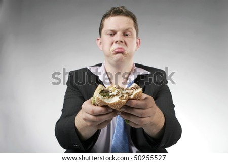 One businessman that does not like hamburger. Focus is on the burger