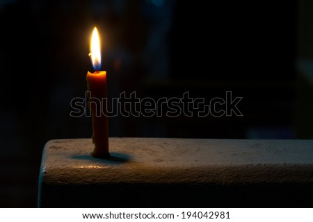 One candle flame at night - stock photo