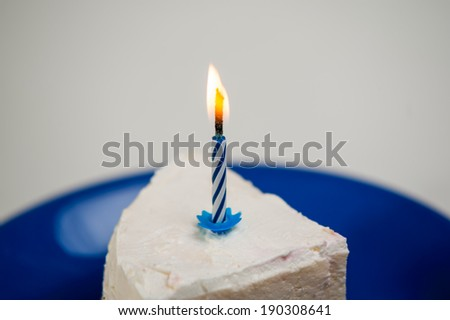 one candle on a cake piece - stock photo