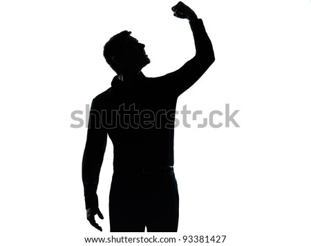 one caucasian business man angry fisting up  silhouette standing Full length in studio isolated on white background - stock photo