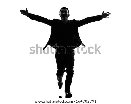 one caucasian business man arms outstretched in silhouette  on white background - stock photo