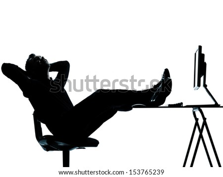 one caucasian business man computer computing relaxing  silhouette Full length in studio isolated on white background - stock photo