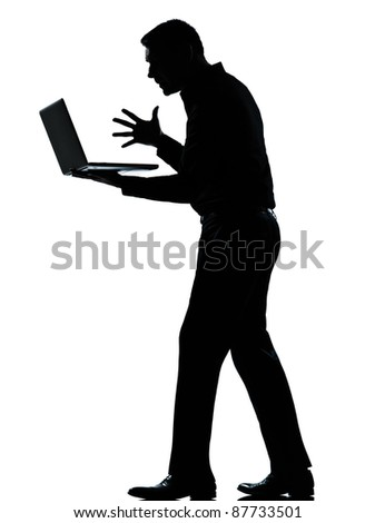 one caucasian business man computing computer laptop angry displeased silhouette standing Full length in studio isolated on white background - stock photo