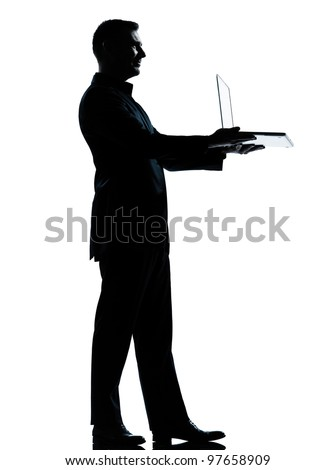one caucasian business man computing computer laptop silhouette standing Full length in studio isolated on white background - stock photo