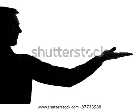 one caucasian business man empty hand open portrait silhouette in studio isolated on white background - stock photo
