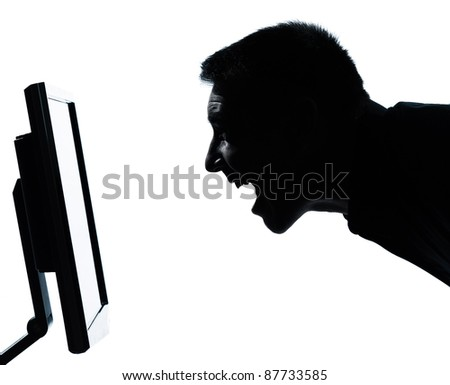 one caucasian business man face happy screaming silhouette with computer screen display portrait in studio isolated on white background - stock photo