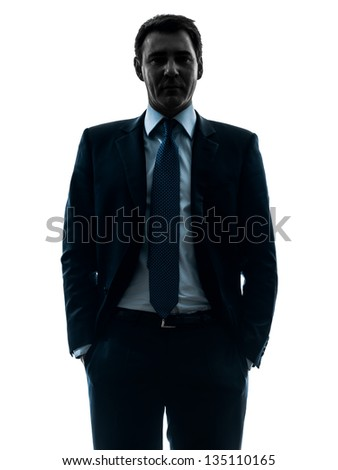 one caucasian business man hands in pocket  in silhouette studio isolated on white background - stock photo