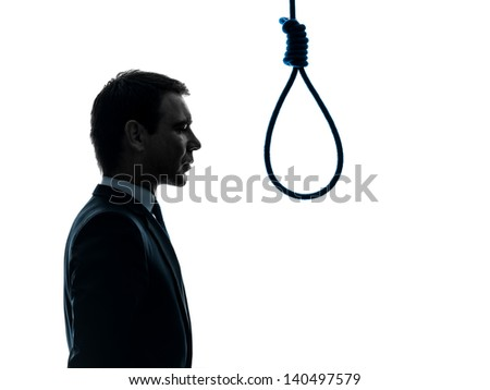 one caucasian business man portrait profile standing  in front of hangman's noose in silhouette studio isolated on white background - stock photo