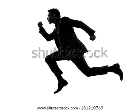 one caucasian business man running in silhouette  on white background - stock photo