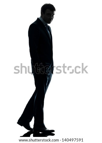 one caucasian business man sad full length   in silhouette studio isolated on white background - stock photo