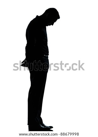 one caucasian business man sad lonely silhouette standing Full length in studio isolated on white background - stock photo
