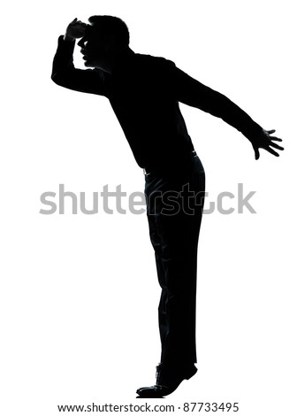 one caucasian business man silhouette standing tiptoe looking away Full length in studio isolated on white background - stock photo