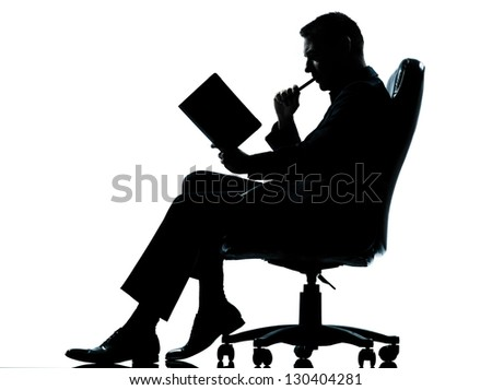 one caucasian business man sitting in armchair silhouette Full length in studio isolated on white background - stock photo