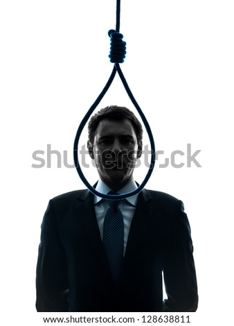 one caucasian business man standing in front of hangman's noose in silhouette studio isolated on white background - stock photo