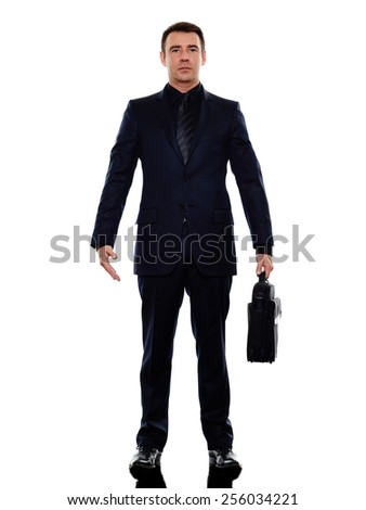 one caucasian business man standing in silhouette on white background - stock photo