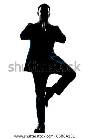 one caucasian business man yoga tree pose  full length silhouette in studio isolated white background - stock photo