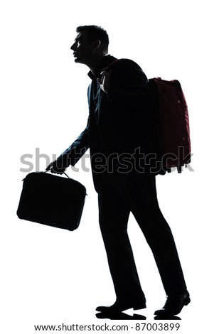 one caucasian business traveler man walking with suitcase on shoulders full length silhouette in studio isolated white background