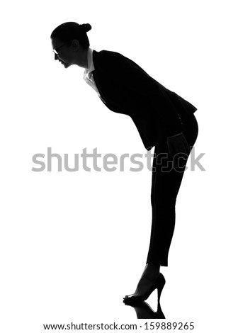 one caucasian business woman saluting bending  in silhouette  on white background
