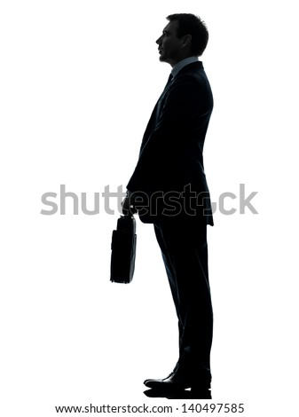 one caucasian businessman standing side view full length in silhouette studio isolated on white background - stock photo