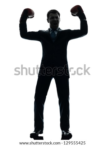 one caucasian businessman with boxing gloves   in silhouette studio isolated on white background - stock photo