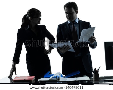 one caucasian busy smiling business woman man couple  in silhouette studio isolated on white background