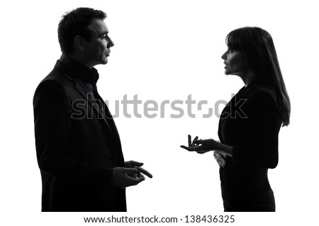 one caucasian couple business woman man in silhouette studio isolated on white background