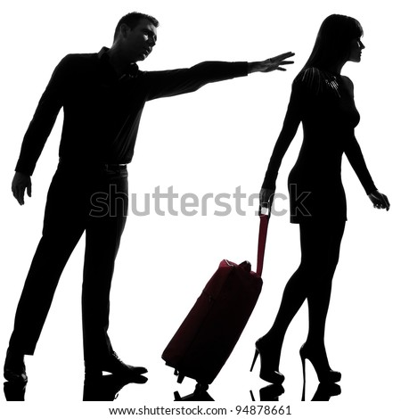 one caucasian couple dispute separation woman leaving and man holding back in studio silhouette isolated on white background - stock photo