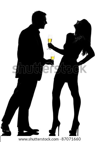 one caucasian couple man and woman driking flirting in studio silhouette isolated on white background - stock photo