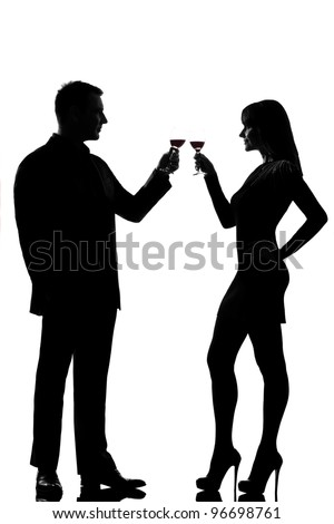one caucasian couple man and woman drinking red wine toasting in studio silhouette isolated on white background